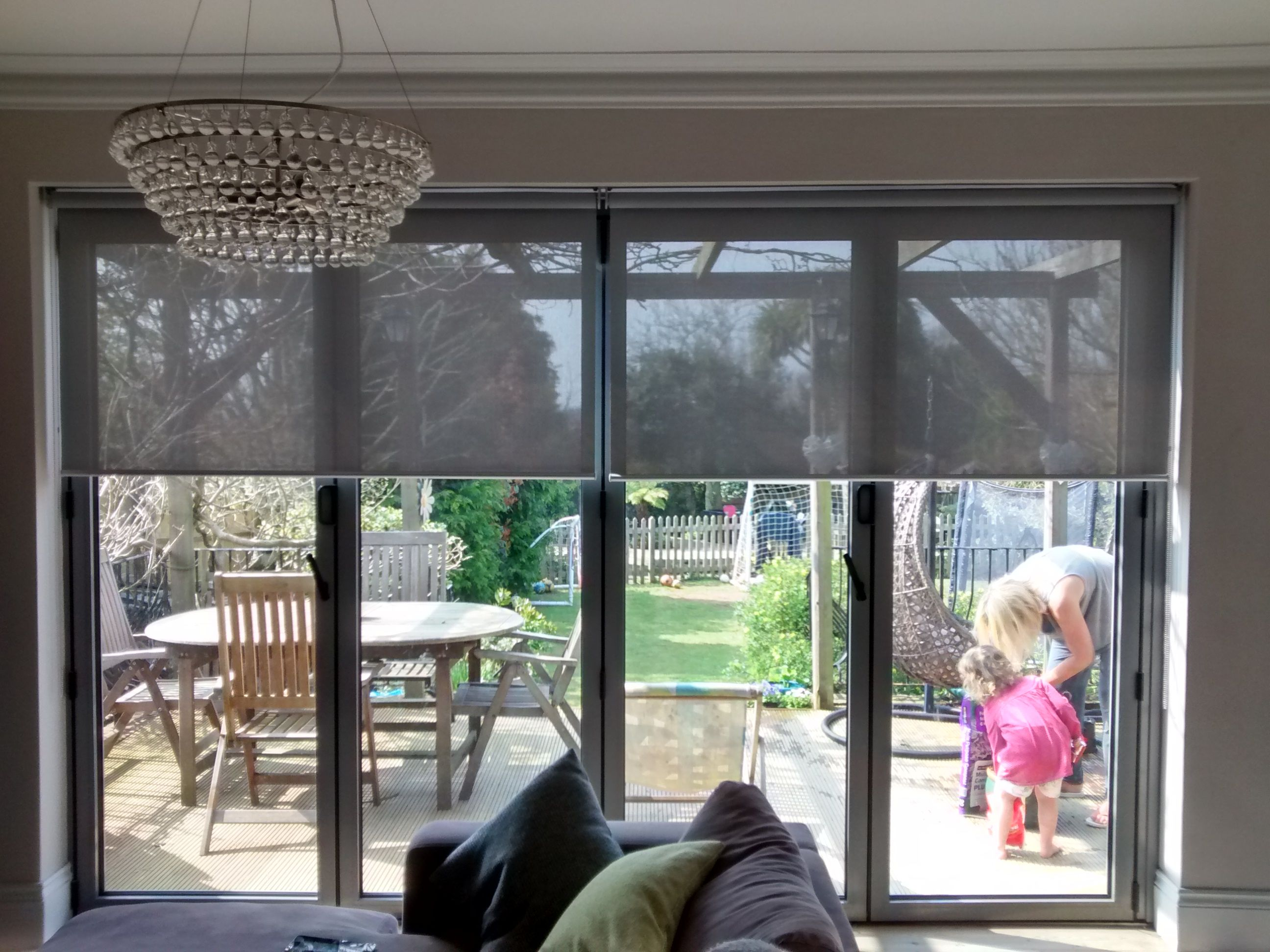 Sunscreen Roller Blinds Over Bi Fold Doors In Living Room. Supplied And  Installed By