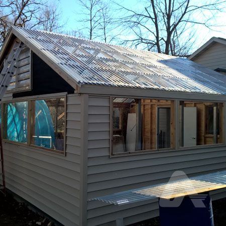 Residential Home With An Attached Greenhouse Roof Greca