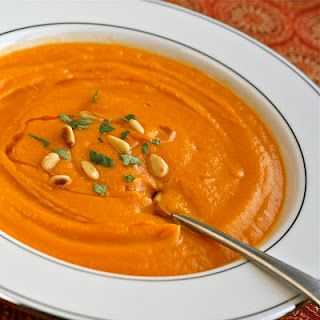 Cream of carrot soup with goat cheese
