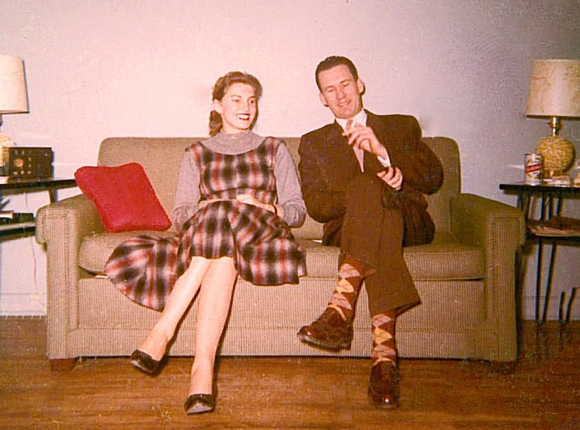 My Mom & Dad on their mid century sofa and apt. Now Mid century is coming back, a bit more mixed then it was before, but back!