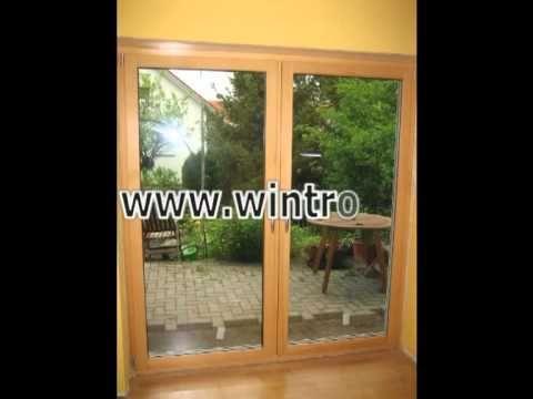 Alte Kunststoff-Balkontür und neue Balkontür aus Holz-Aluminium -------- old door of pvc and new door of wood-aluminium