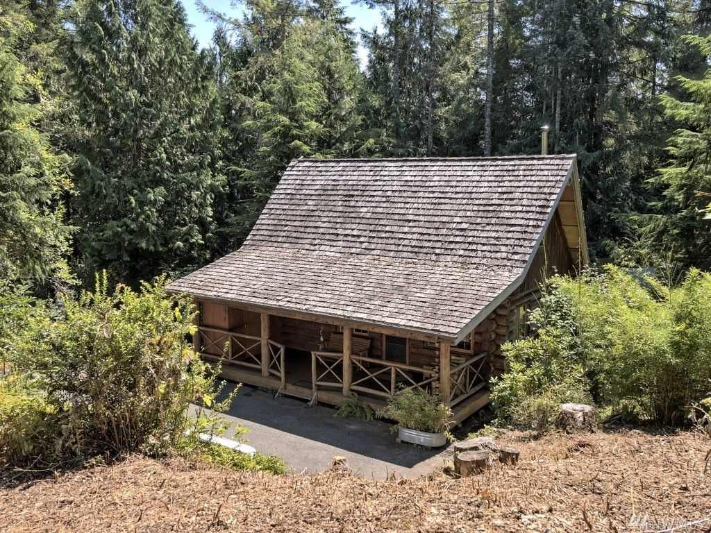 curbed neighborhood sale house a the by log for seattle tiny square sits sea foot washington cabins in state juan san islands