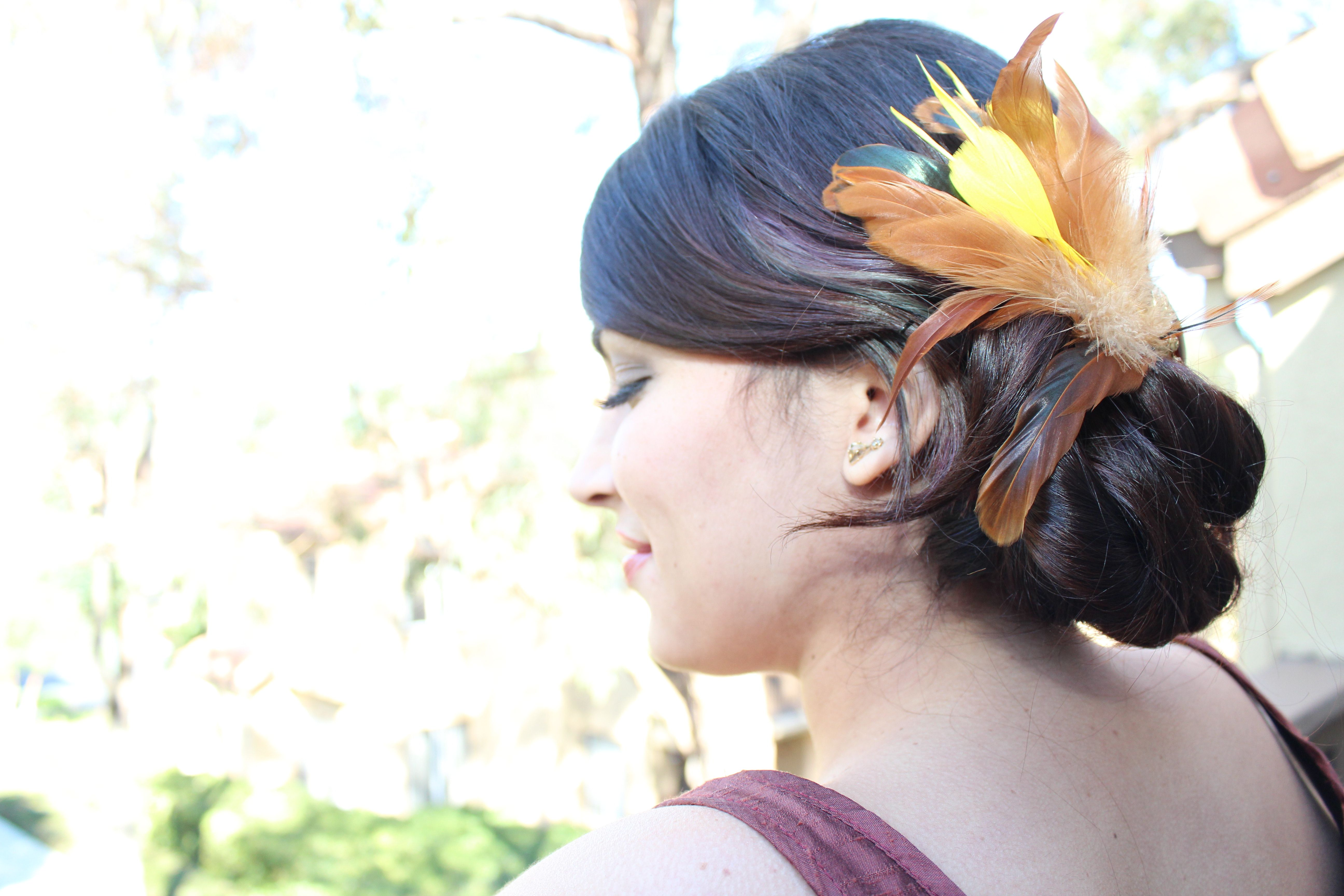 side view of Kristen\'s up do with feather hair piece. | Kristin\'s ...