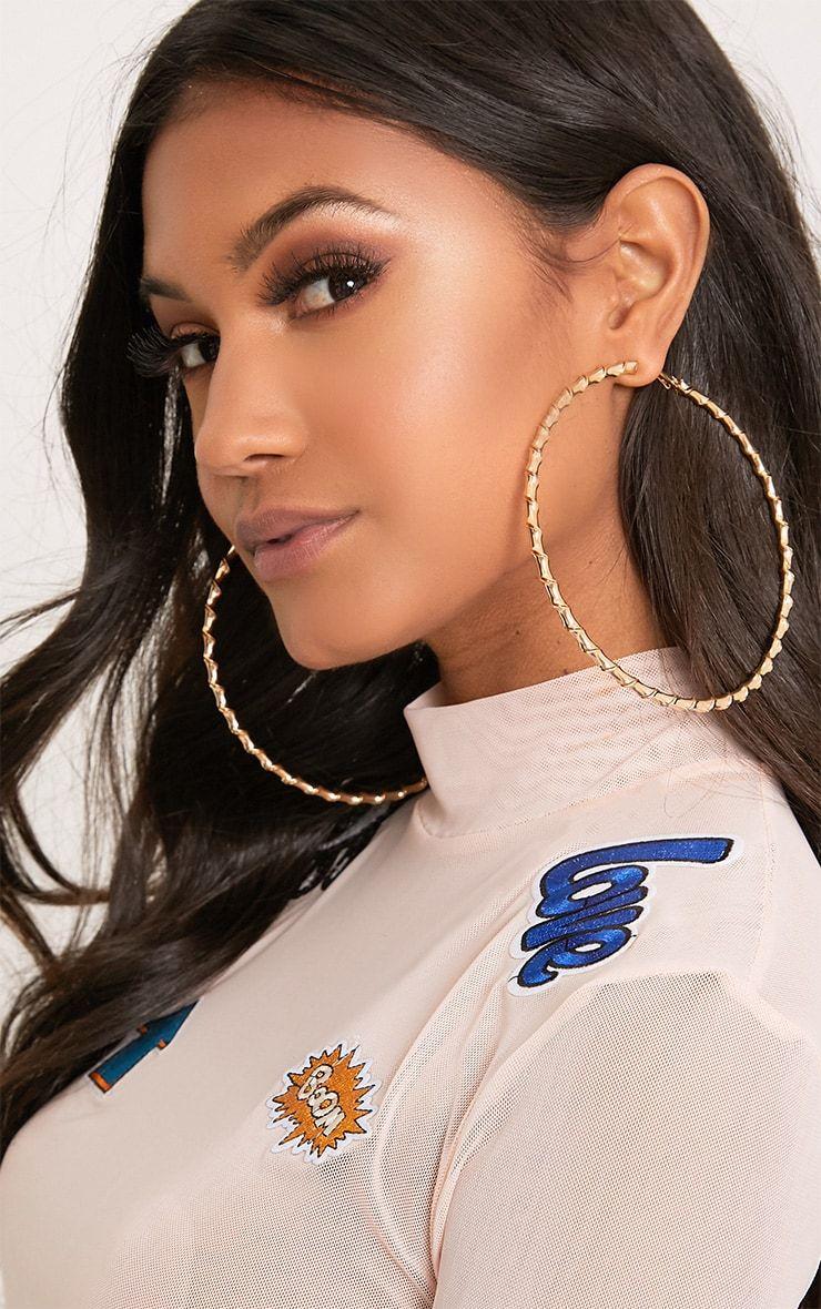 Brynn Gold Big Twisted Metal Hoop Earrings. Shop the range of earrings  today at PrettyLittleThing USA. E… | Big hoop earrings, Hoop earrings  small, Sparkly earrings