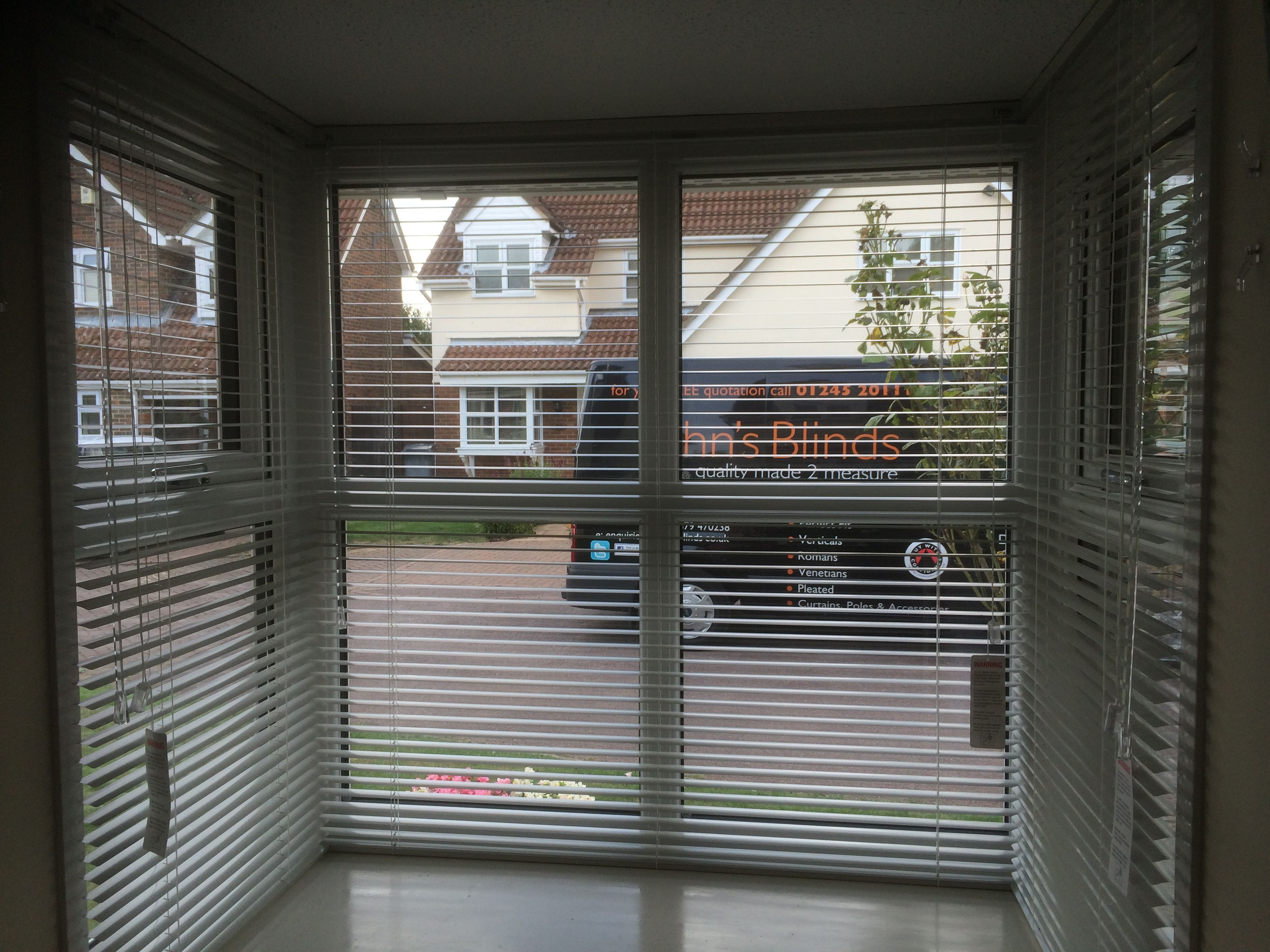 Aluminium blinds in a square bay window blinds venetians style