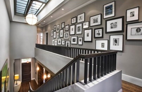 Grey Walls White Trim Black Frames In The Hall
