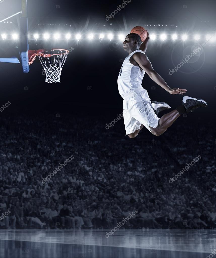Basketball Player Scoring An Athletic Amazing Slam Dunk Stock Photo Spon Scoring Athletic Basketball Play Basketball Players Basketball Slam Dunk