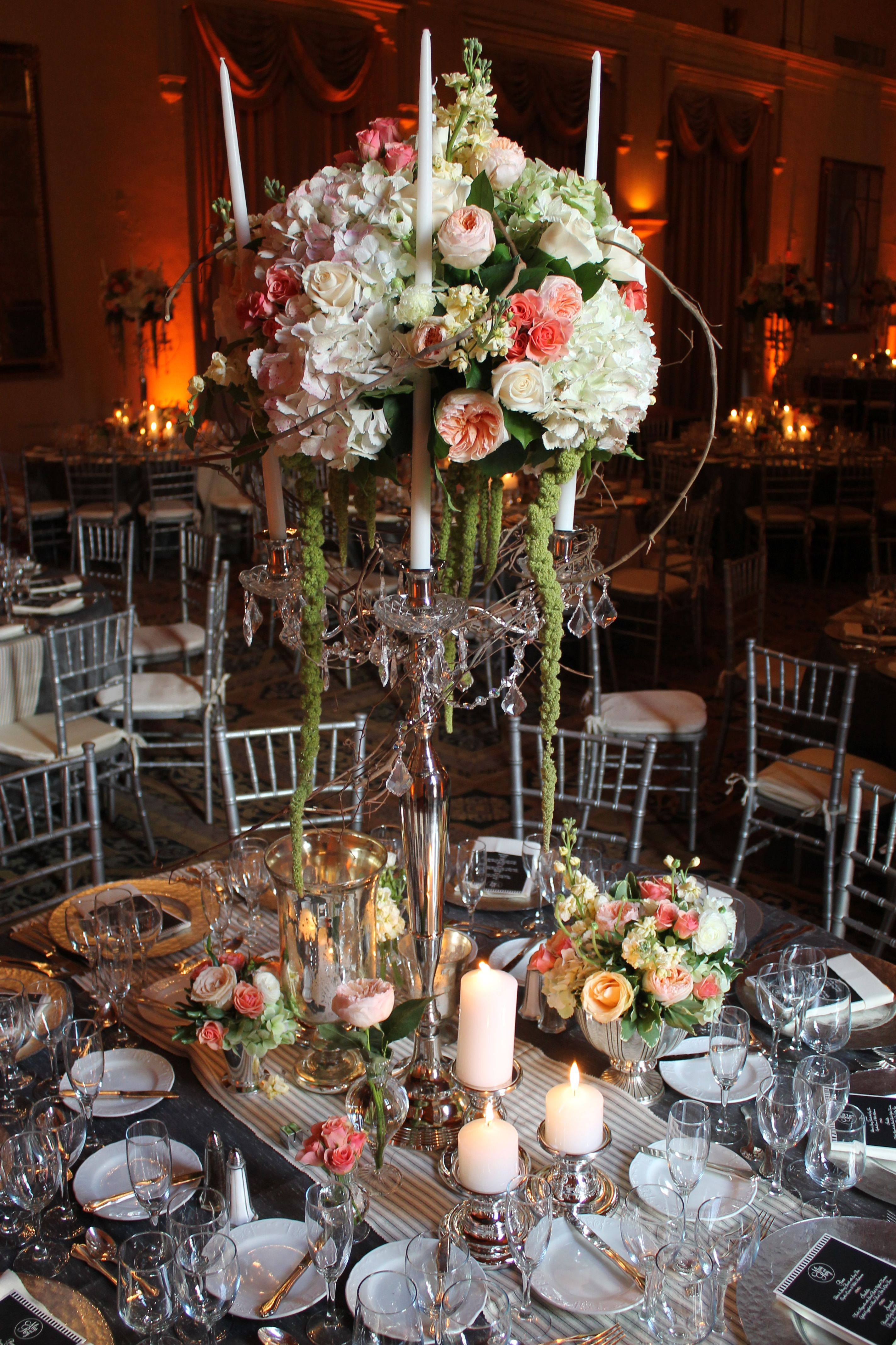 Cluster of florals on a candelabra by Avant Gardens Miami
