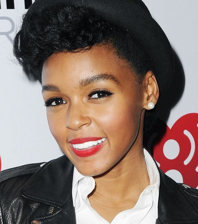 Janelle Monae's signature red lip color and brushed up brows are perfect