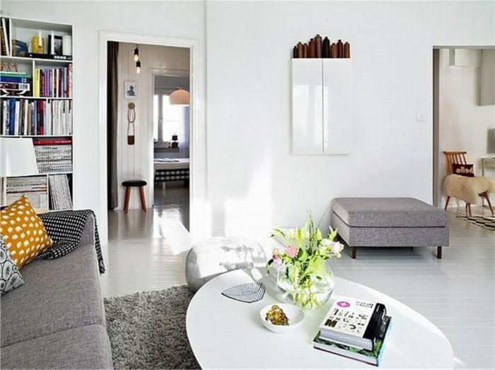 salón bonito con mesa oval en blanco y sofá en gris, como decorar un ...