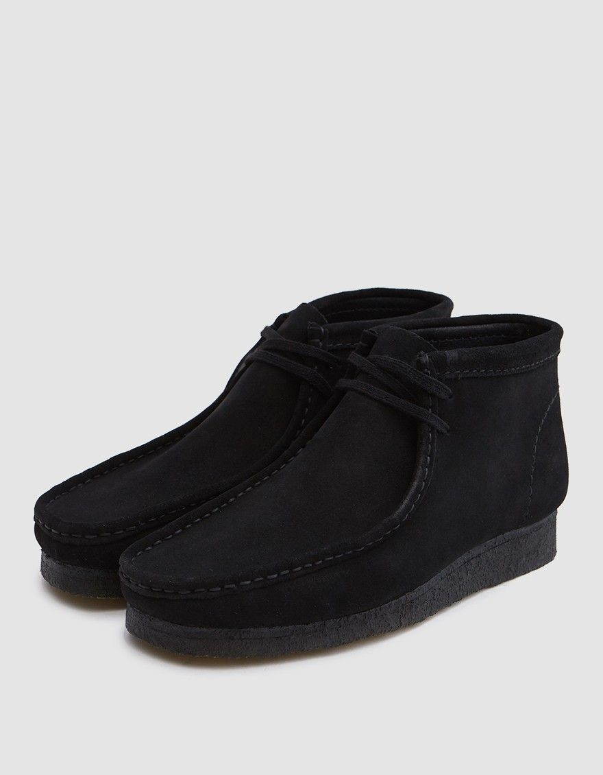 wholesale dealer 0fe84 cae9a Wallabee boot from Clarks in Black. Suede upper. Moccasin construction.  Lace-up front with flat woven laces. Tonal stitching. Padded footbed with  embossed ...