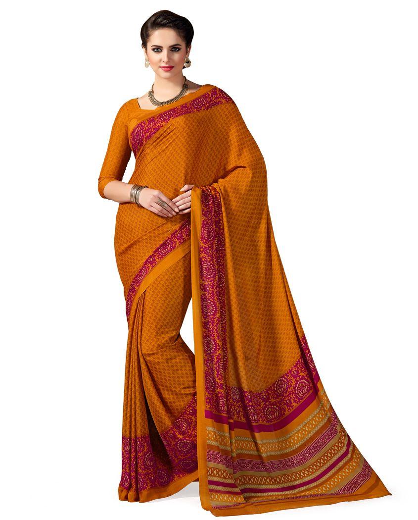 mustard crepe silk printed sari comes with a matching