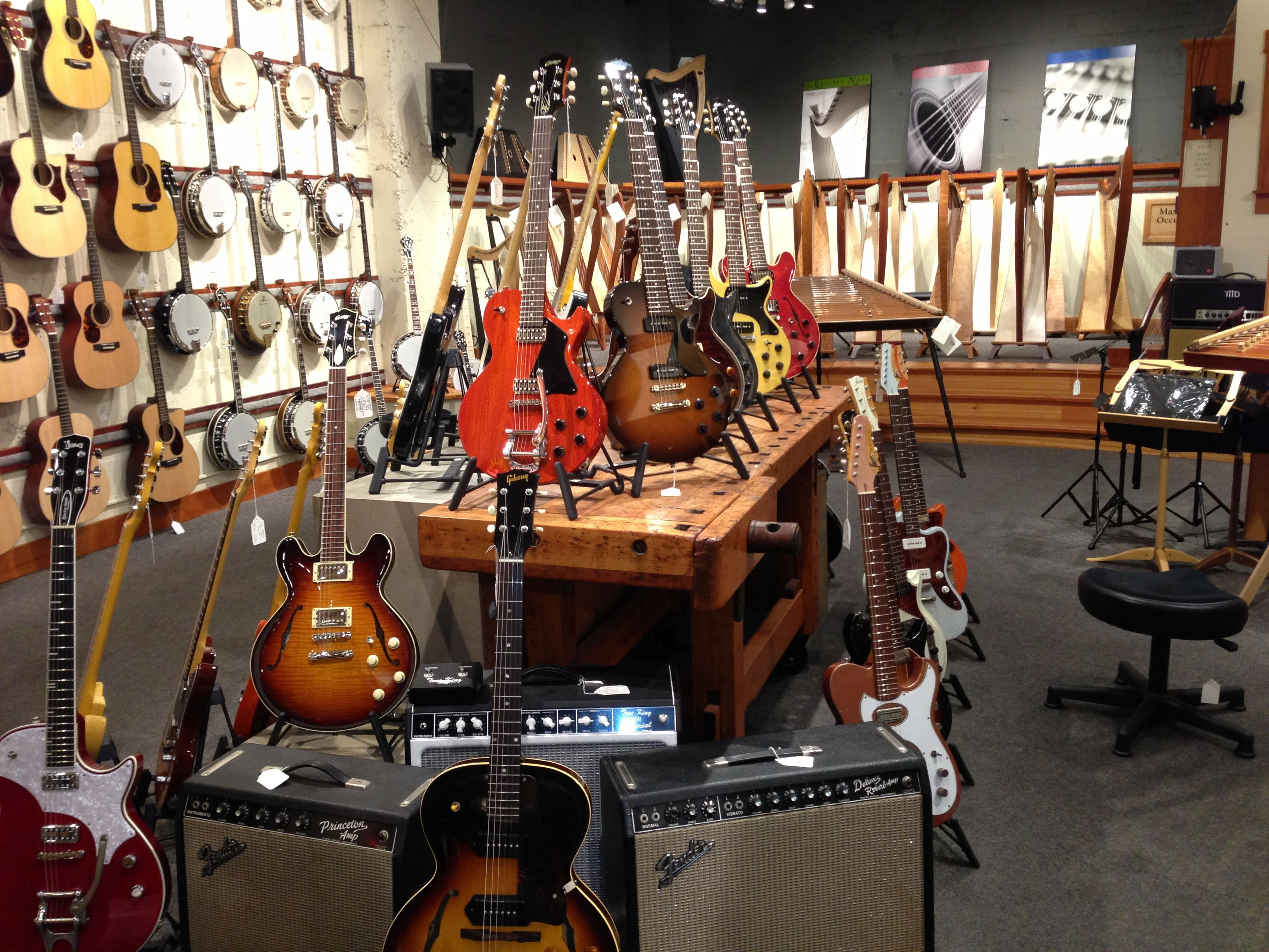 Dusty Stings Acoustic Music Shop S Collection Of Electric Guitars Music Store Interior Store Layout Music Shop