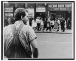 [A New York plumber, from Local 2 of the Plumbers' Union, watches civil rights demonstrators picketing the Union office following the Union's refusal to work on a $25 million construction project in the Bronx after four non-union members were hired]