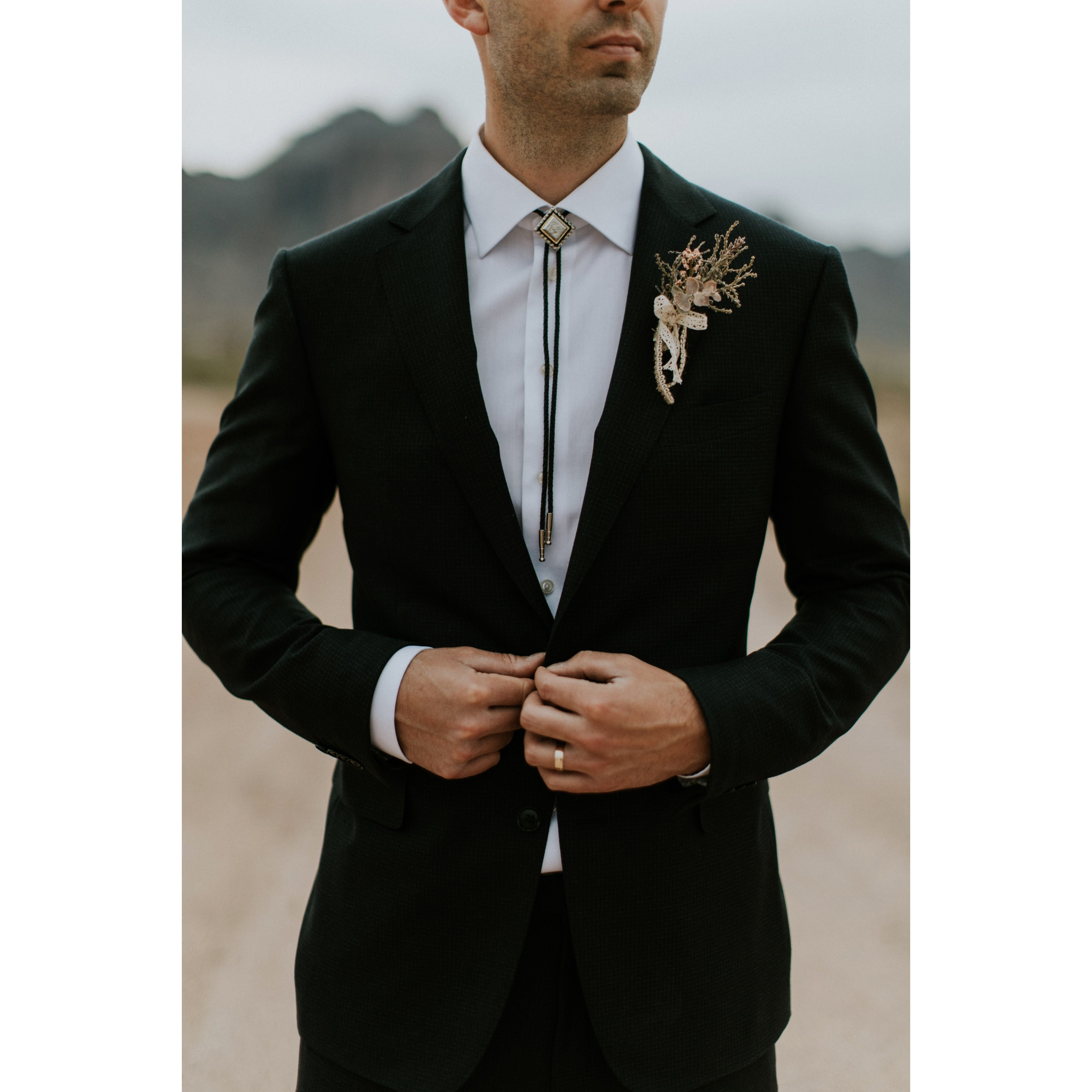 Bolo tie boutonniere southwest groom style photo by
