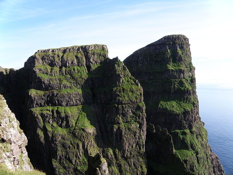 Beinisvørð and Hesturin, the west coast of Suduroy, Faroe Islands.. Beinisvørð, a 470 meter high cliff in Suðuroy, Faroe Islands., Suðuroy.