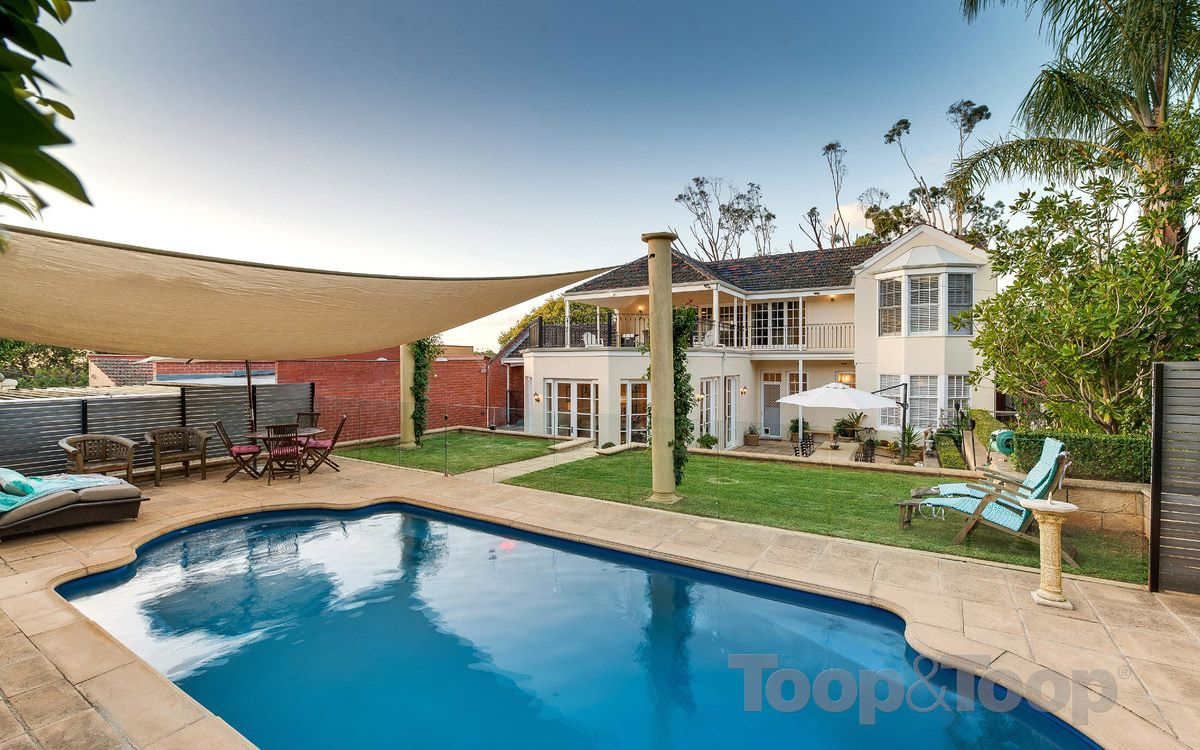 This spacious house has luxury modern features and a large, segmented back yard with a swimming pool. Beaumont. Adelaide. InDaily. Living.