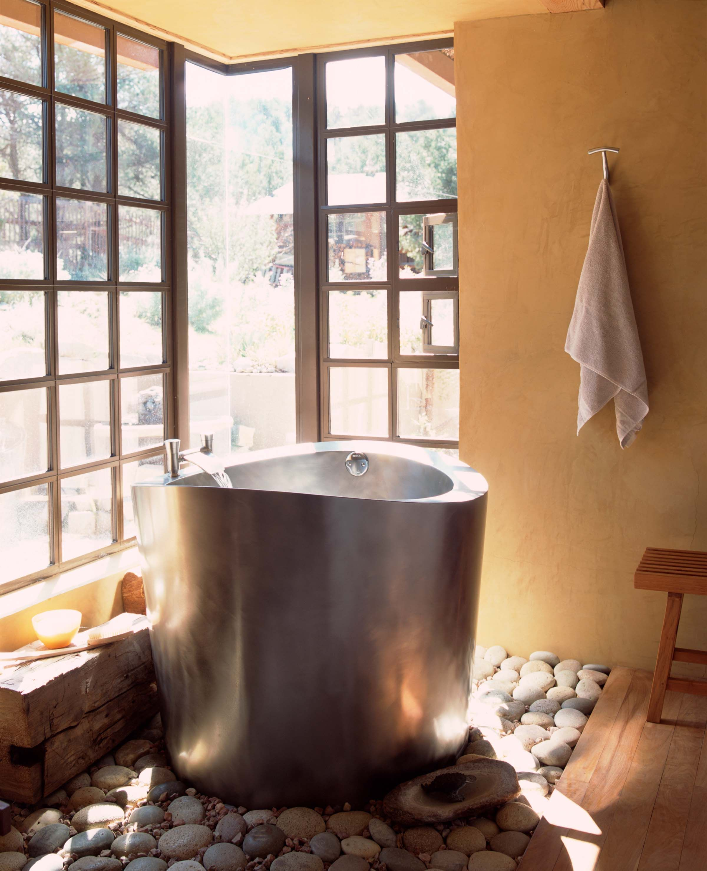 This Japanese Styled Stainless Steel Ofuro Tub Is Made For One Bather Situated Atop Of Bed Of