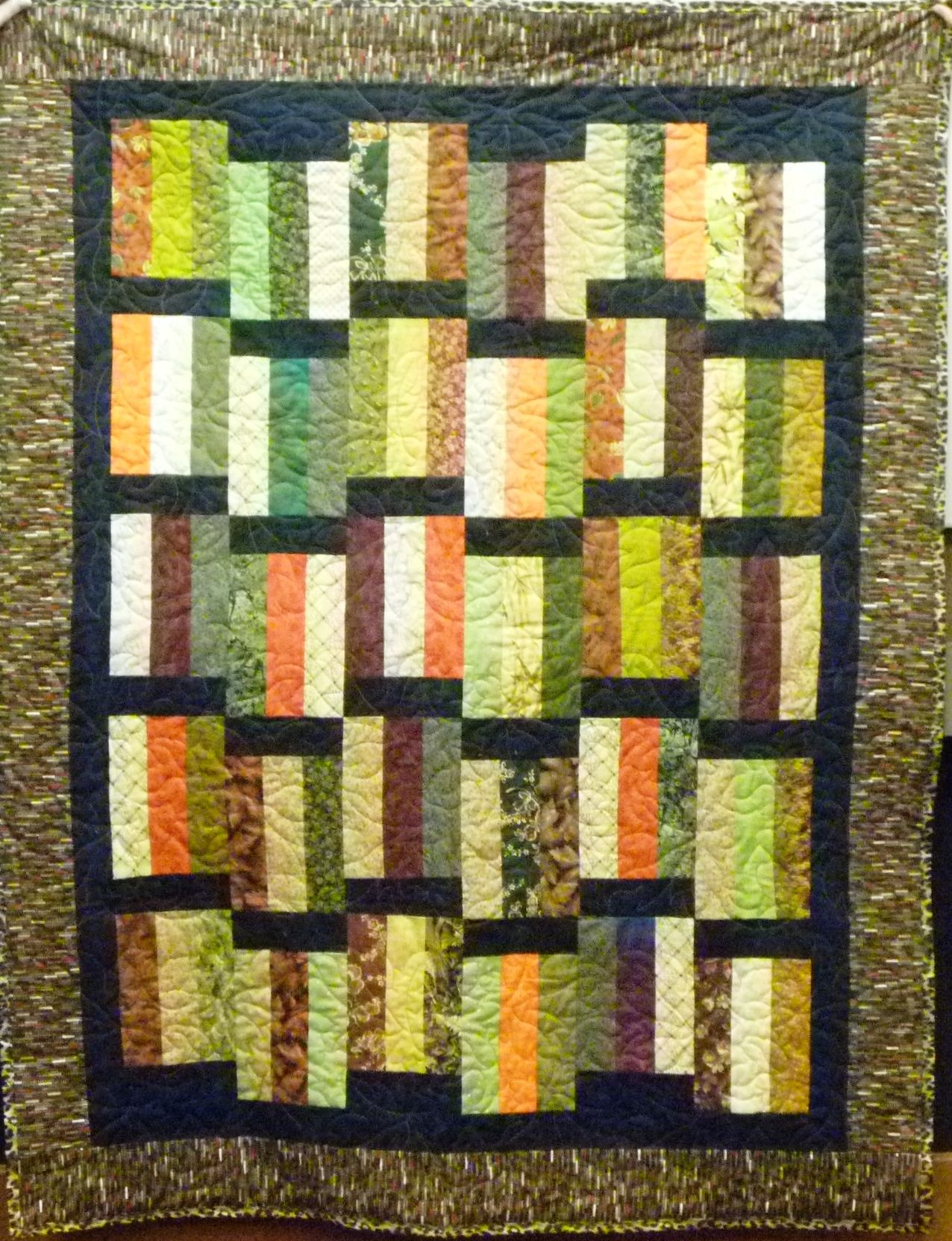 Love the earth tones in this quilt, by Madeline Furtado.