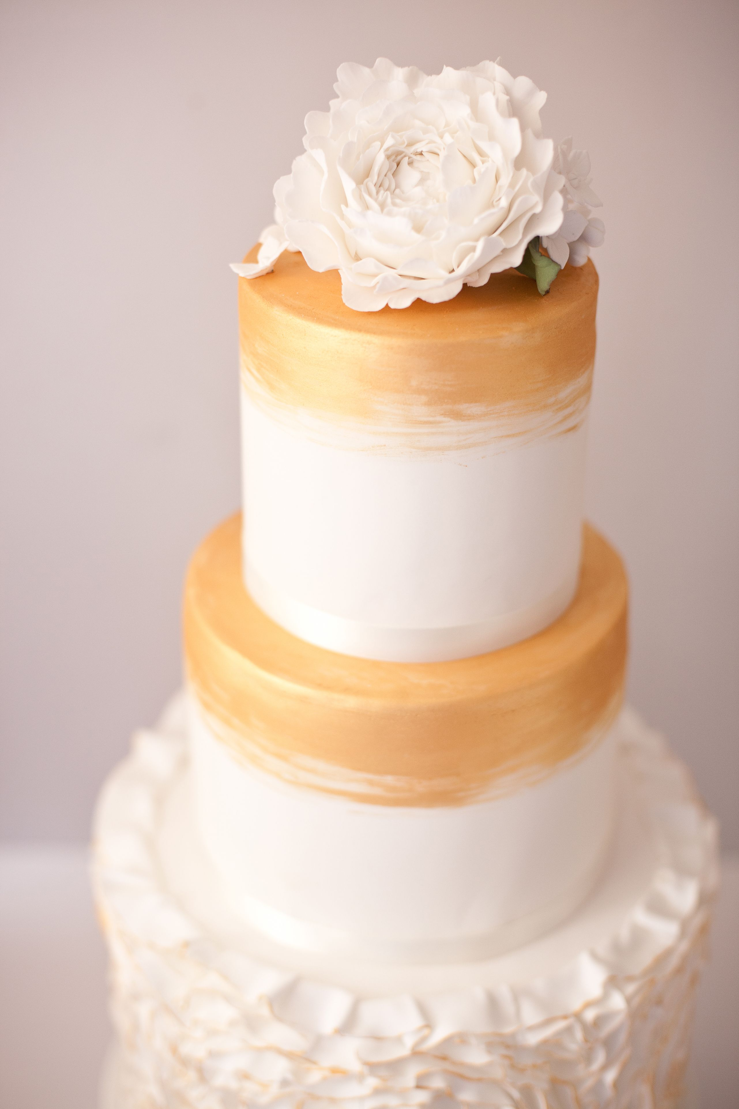 Modern Gold Ruffles Wedding Cake by S K Cakes www.s-k-cakes.co.uk