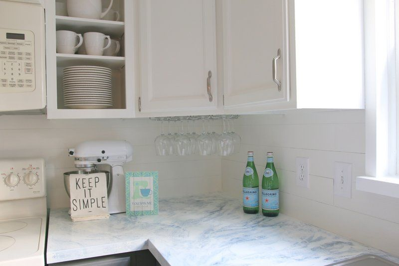 fixer upper inspired kitchen updates using paint!! and this faux shiplap backsplash is made out of peel 'n stick vinyl tiles for $20 and FAUX MARBLE painted countertops! all updates for about $300 - wow....