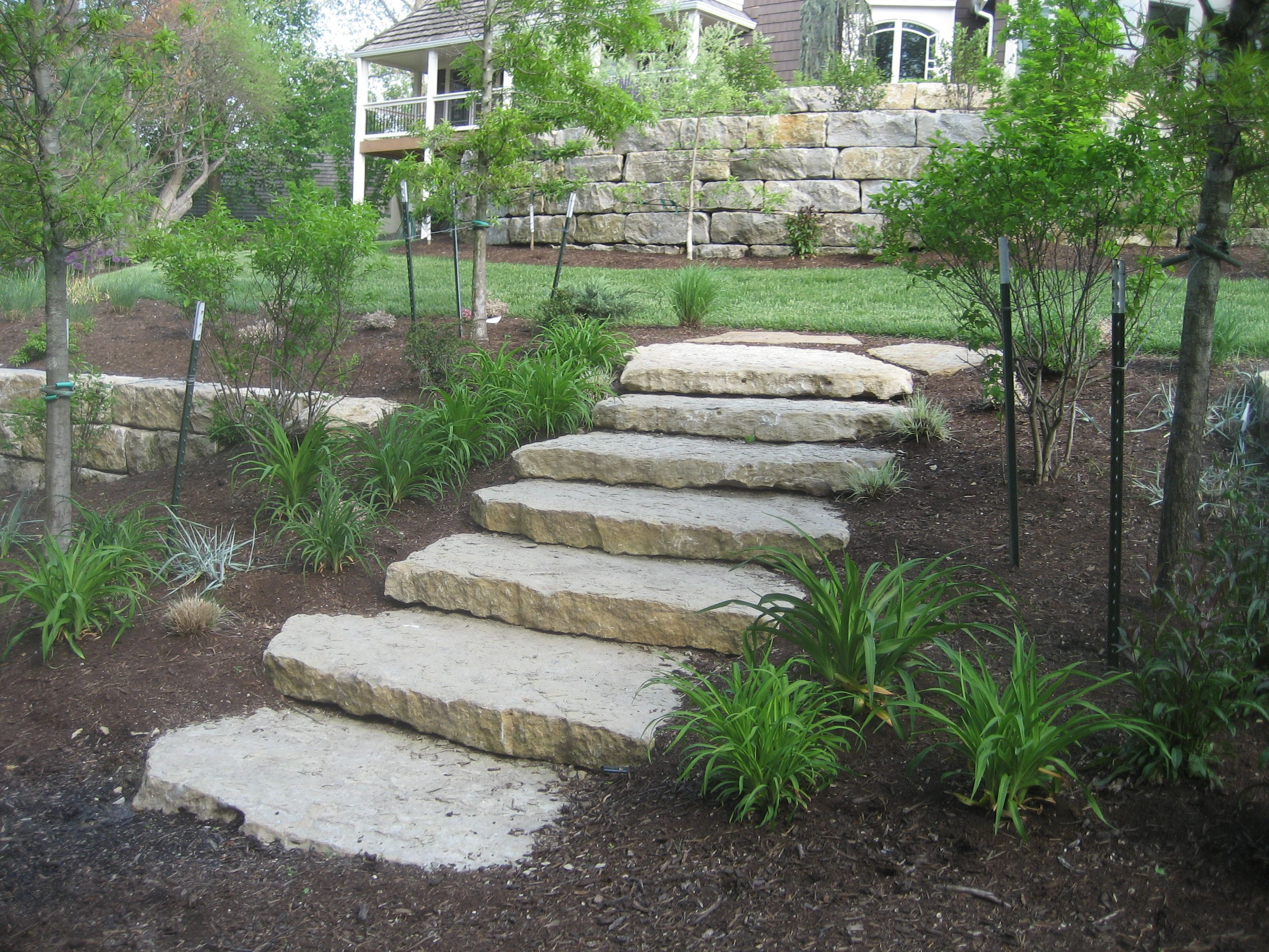 Ledge Stone Steps Transition Between Garden Terraces
