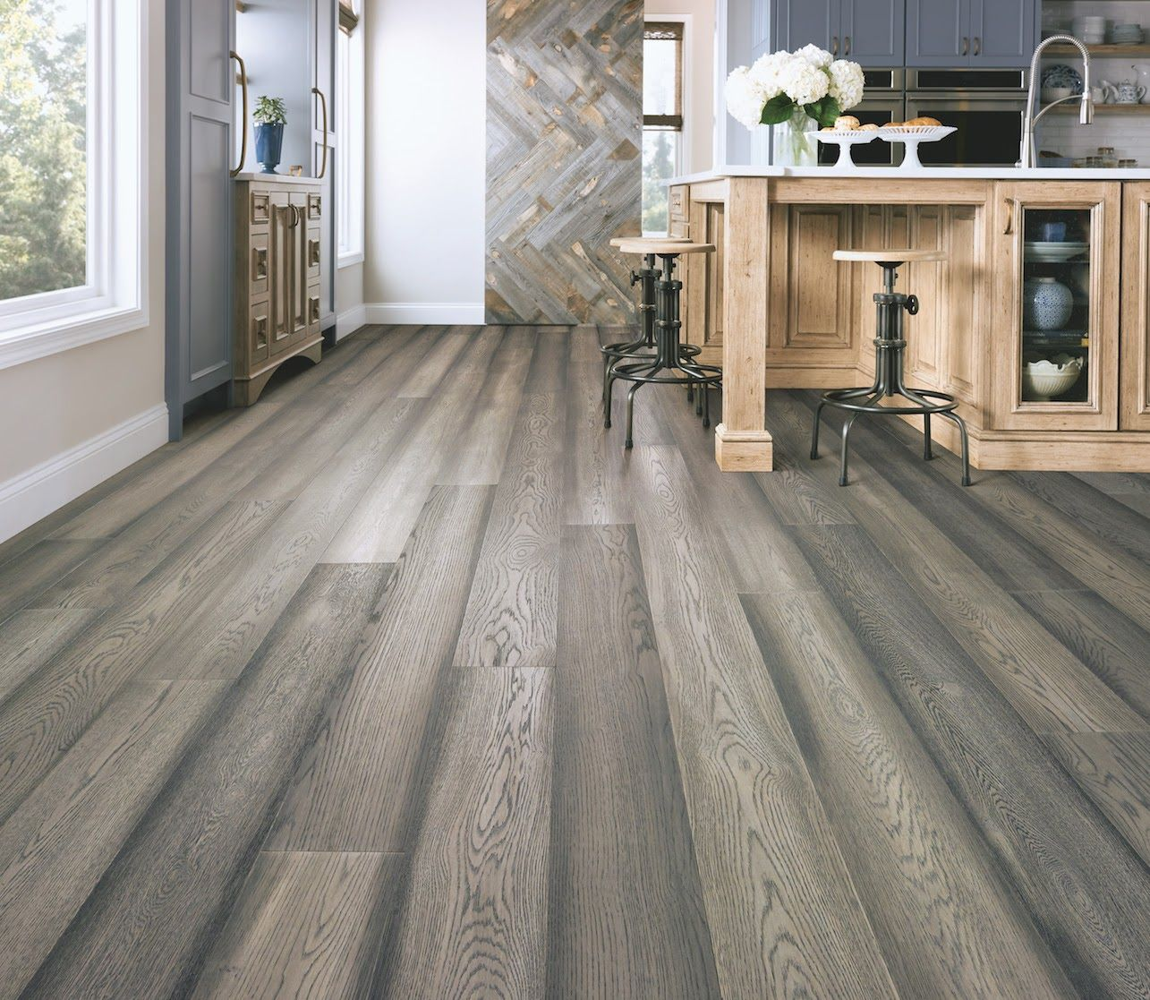 Love The Luxe Look Of Hardwood Floors In A Kitchen But Fear It Won T Stand Up To The High Foot Traffic And Multipl In 2020 Waterproof Hardwood Wooden Flooring Hardwood