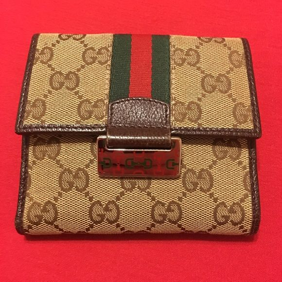 7d13904481e Gucci classic wallet Authentic Gucci wallet in the classic monogram and red    green stripe. Great condition. No peeling or tears.