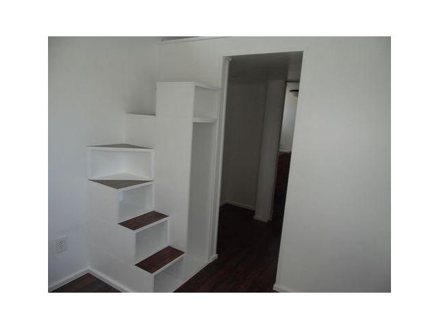 Curved Stairs Leave Space For An Extra Closet (8x24 Birchwood Tiny House  For Sale)