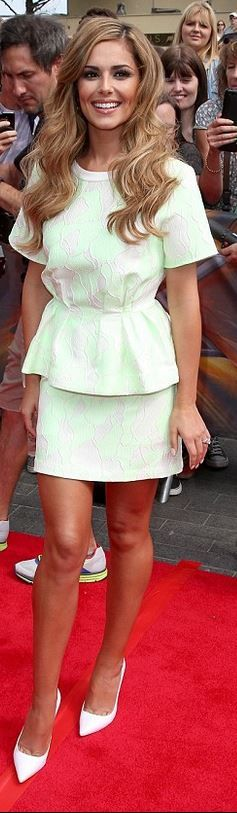 Who made Cheryl Cole's short sleeve peplum top and green print skirt? Shirt and skirt – 3.1 Phillip Lim