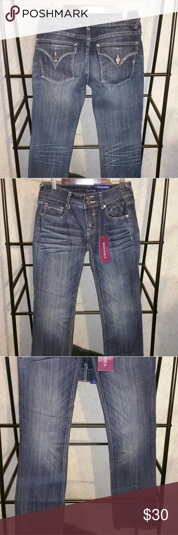 New with tags Vigoss jeans New Vigoss jeans. Love these jeans. Cute v flap pockets. Boot cut. 33in inseam 27w. New with tags. Double button front. Adorable. Vigoss Jeans Boot Cut