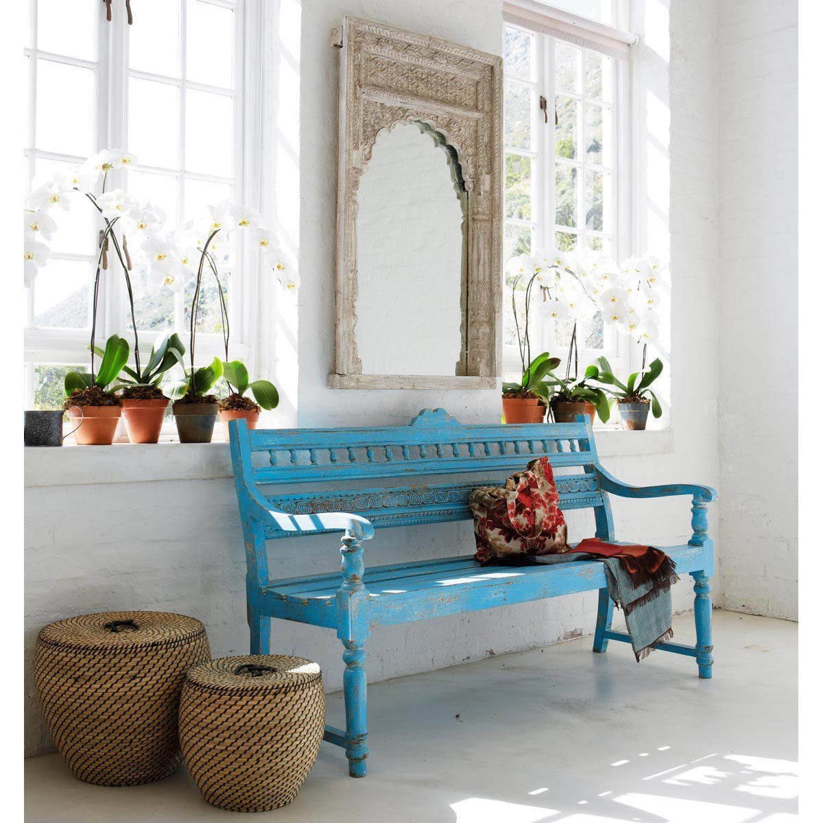 Bengalore bench. This charming mango wood bench comes in a turquoise blue that has been given an antiqued, patina finish.