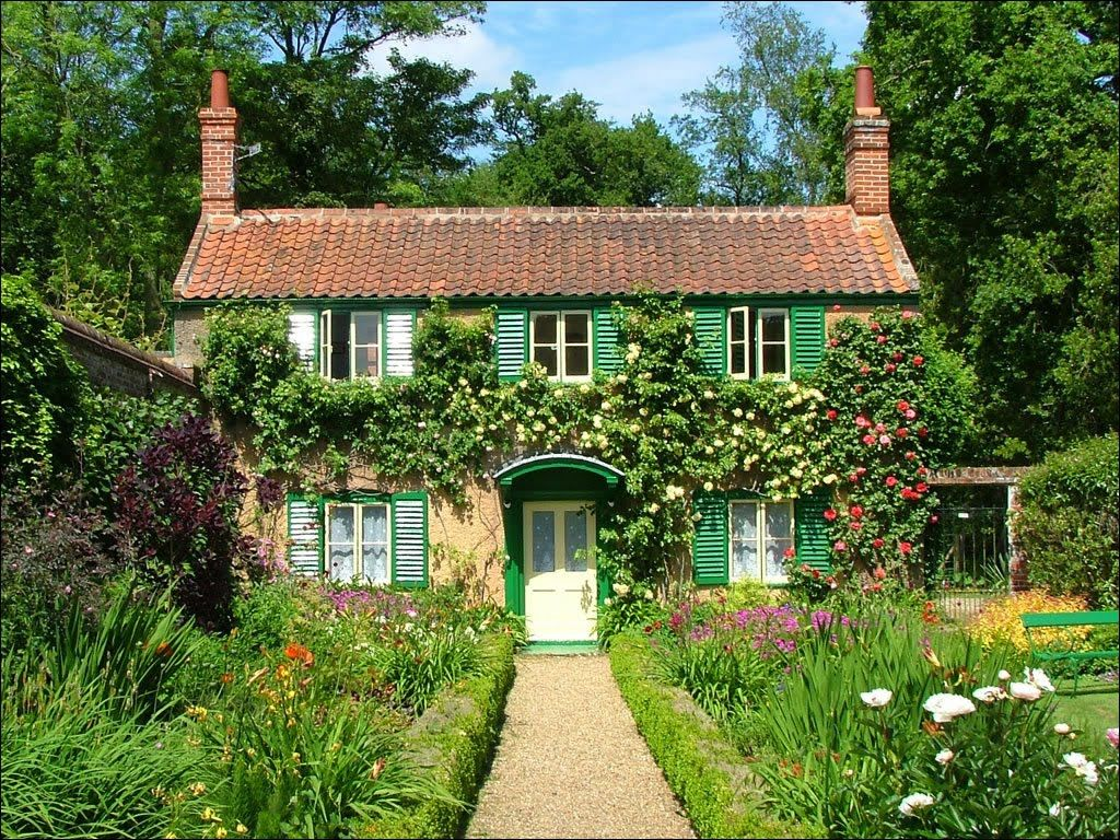 Home garden style  A beautiful cottage with red brick roof chimneys large garde