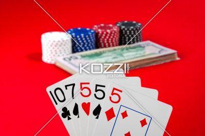 triple five - Poker hand displaying three fives.