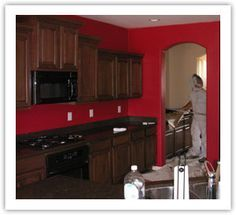 red accent wall in kitchen with brown cabinets - Google ... on painting kitchen cabinets, kitchen paint ideas with black appliances, kitchen cabinets with light in dark paint, black granite countertops with dark cabinets, kitchen colors, flooring ideas with dark cabinets, kitchen remodeling ideas,