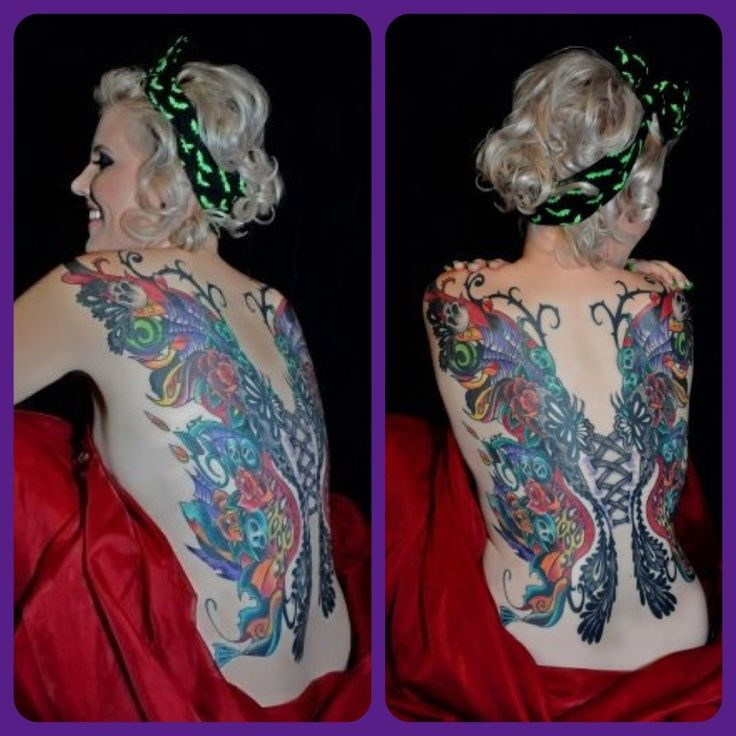 back tattoos with lace and flowers | Full back tattoo wings with skulls, roses, leopard, and lace corset ...