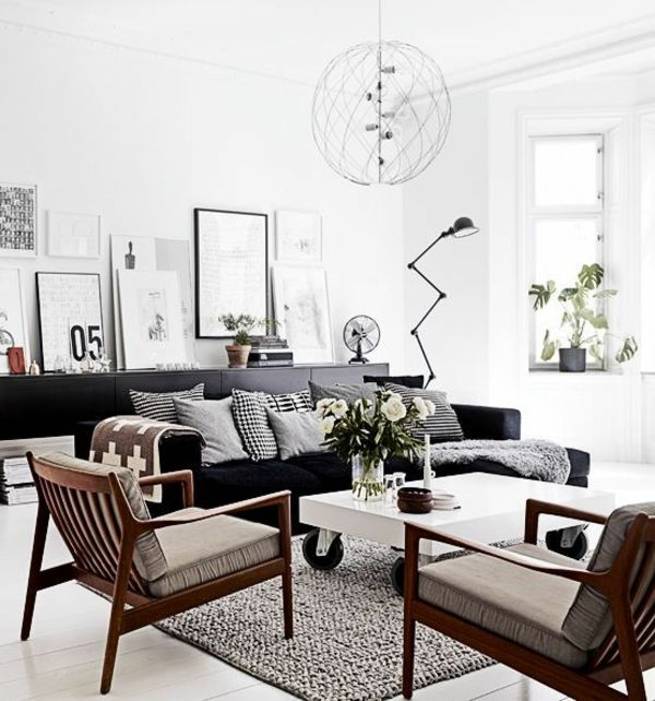 Wohnzimmer Einrichten Skandinavischer Stil Holzmöbel Schwarzes Sofa
