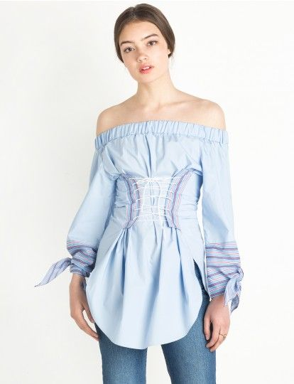 2e5121ed99c Light blue off the shoulder oversize top with striped sleeve cuff and  optional white corset waist tie.