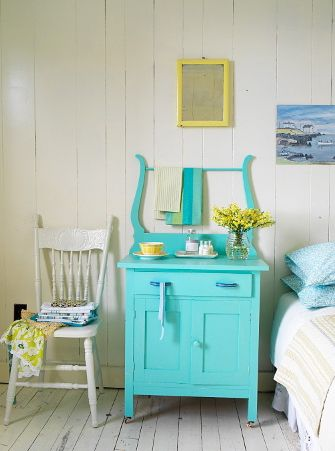 white bedroom with bright turquoise side table (Benjamin Moore, Tropicana Cabana)