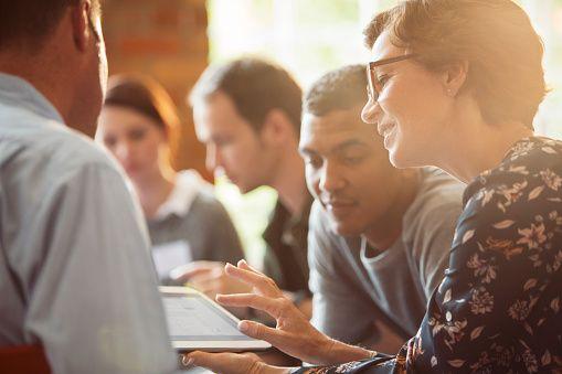 Business People Sharing Digital Tablet In Meeting Fotos