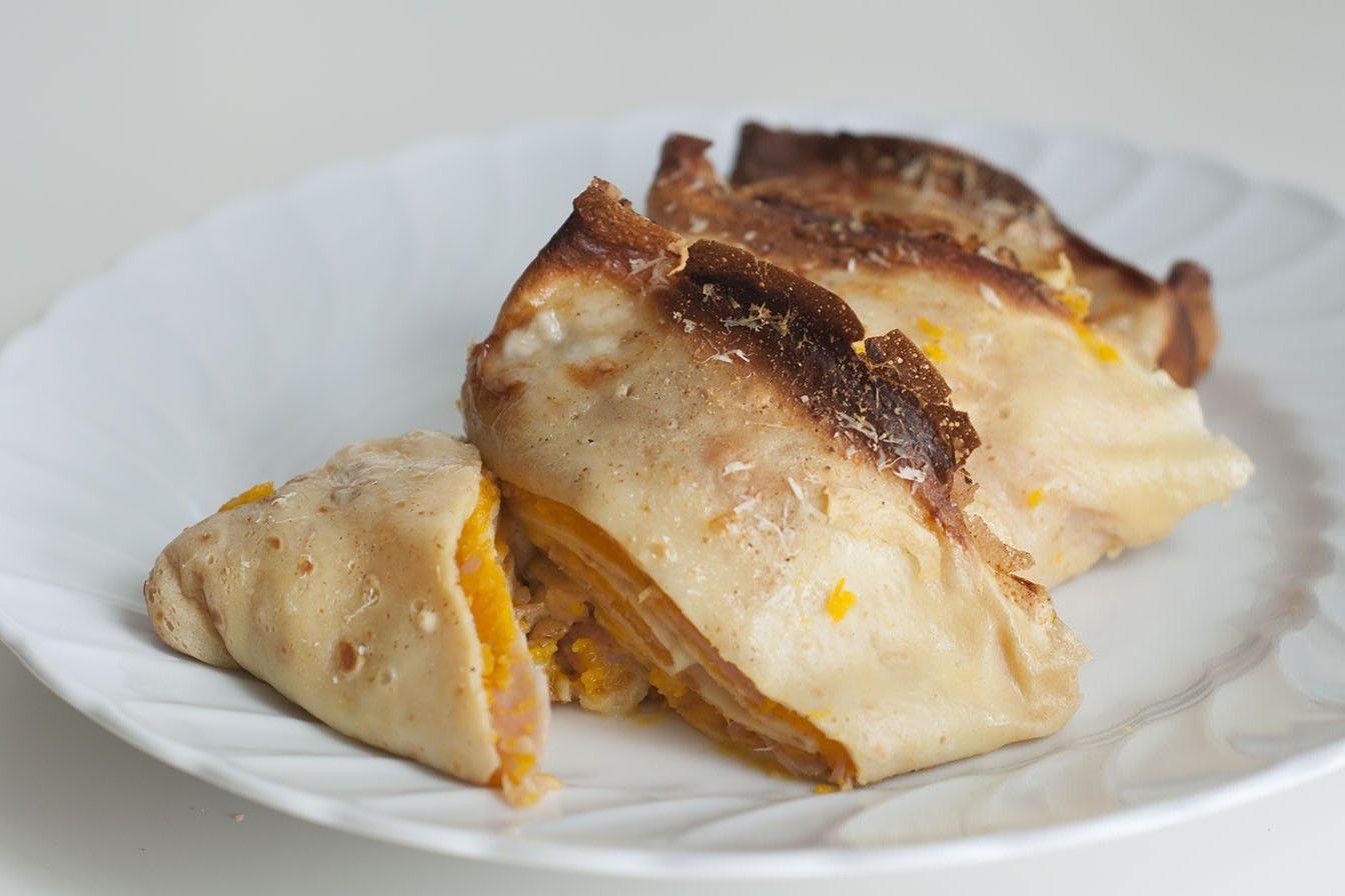 Crepes cremose con zucca, speck e gorgonzola
