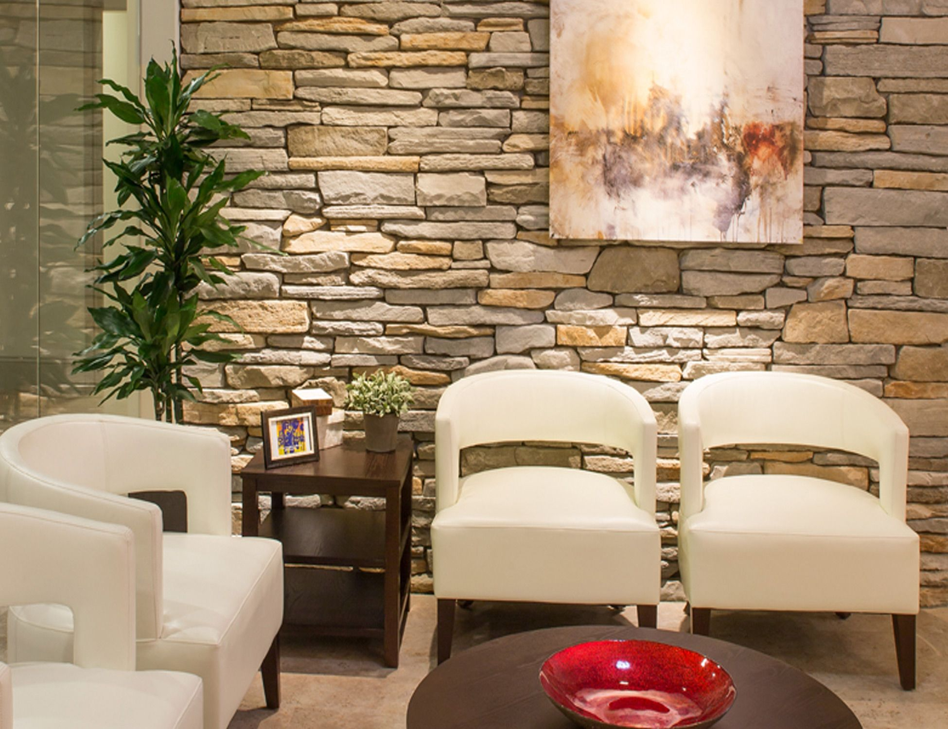 Texture and lighting create a welcome inviting waiting Chiropractic office designs