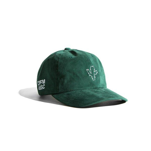 Green baseball cap with curved brim. White embroidery at the front and  lettering print at side.