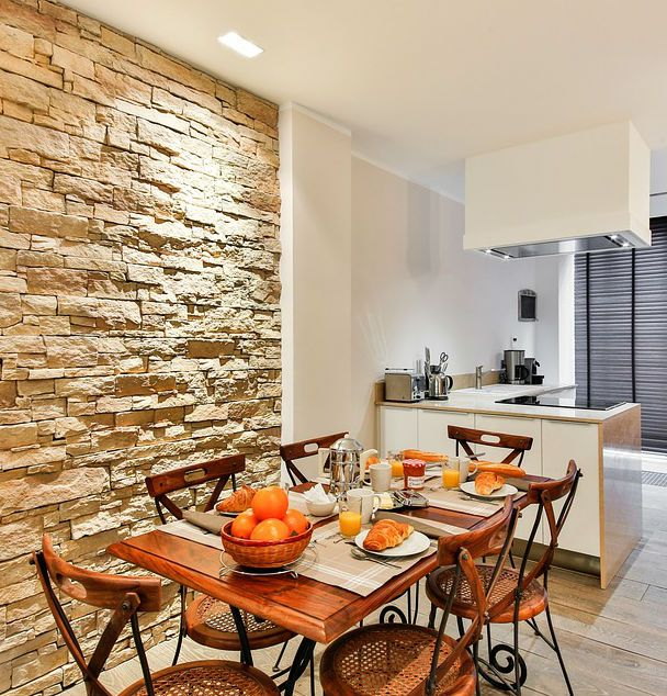 Interior Stone Wall Kitchen: Lovely Kitchen Design With An Accent Stone Wall. #mortonstones #brick #wall #home #decor