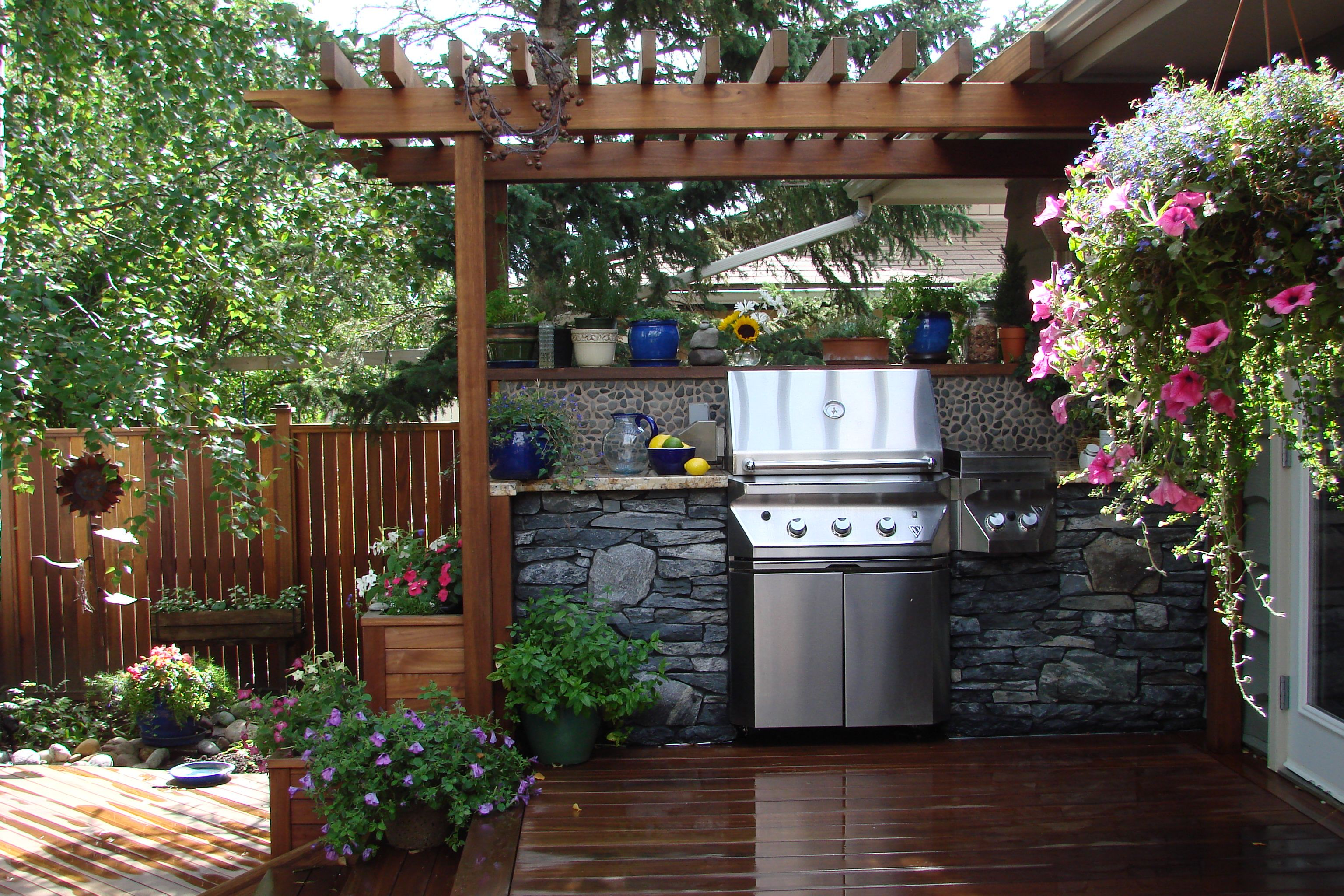 Nice Place For A Bbq With Tropical Hardwood Supplied By Kayu Canada Inc For This Back Yard Located In Calgary Alberta Backyard Patio Outdoor Pergola Pergola