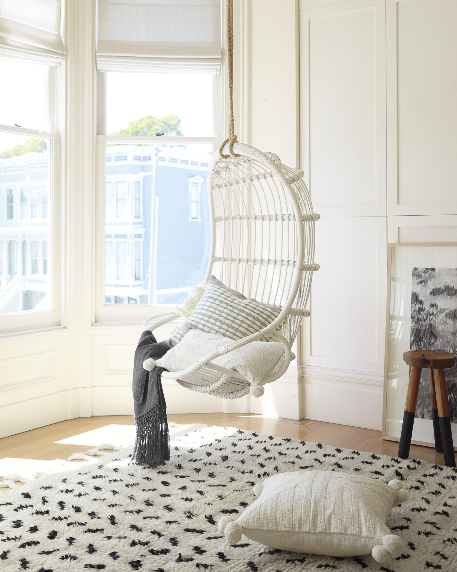 Hanging Rattan Chair & Huxley Wool Rug via Serena & Lily