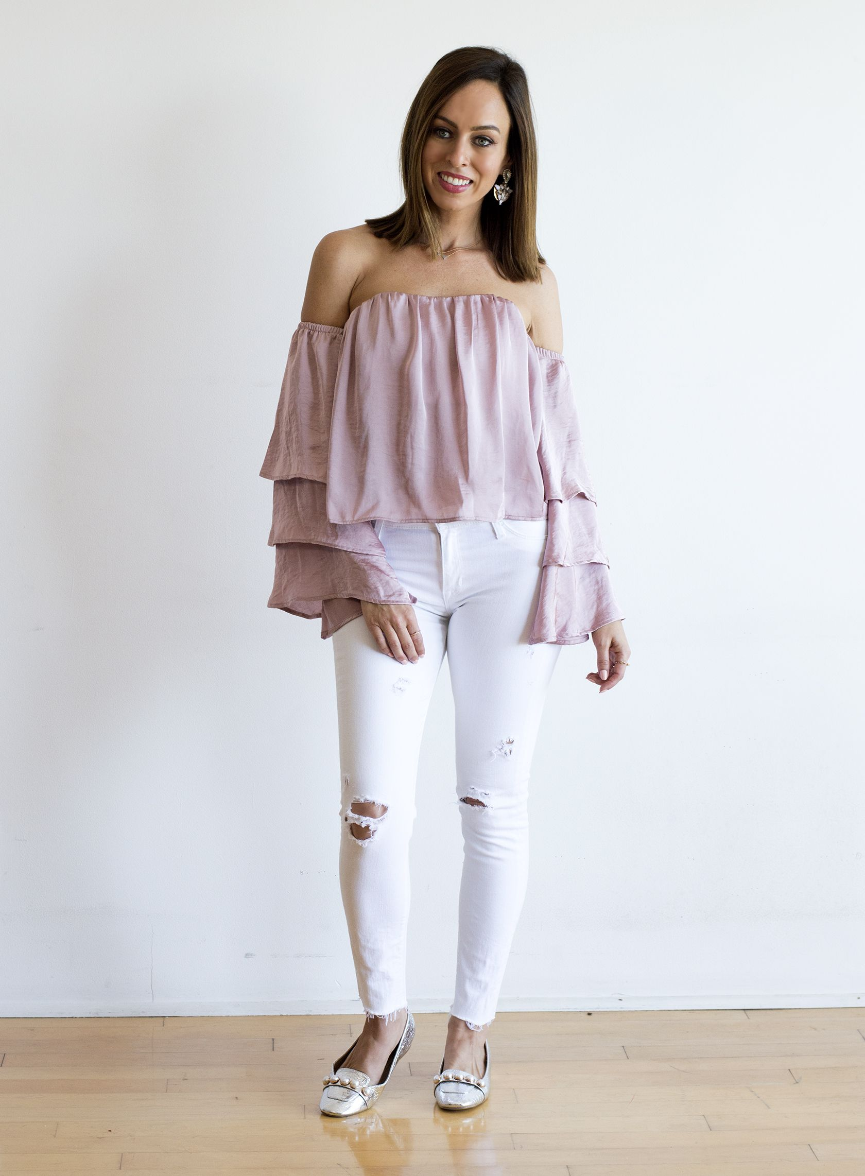 c01908d7c6f Sydne Style shows how to wear the off the shoulder trend with summer outfit  ideas in white jeans