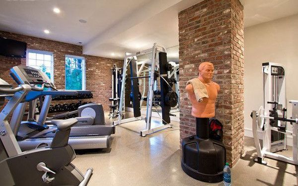 Nice Home Gym Studio With Machines Rack And Punching Bag
