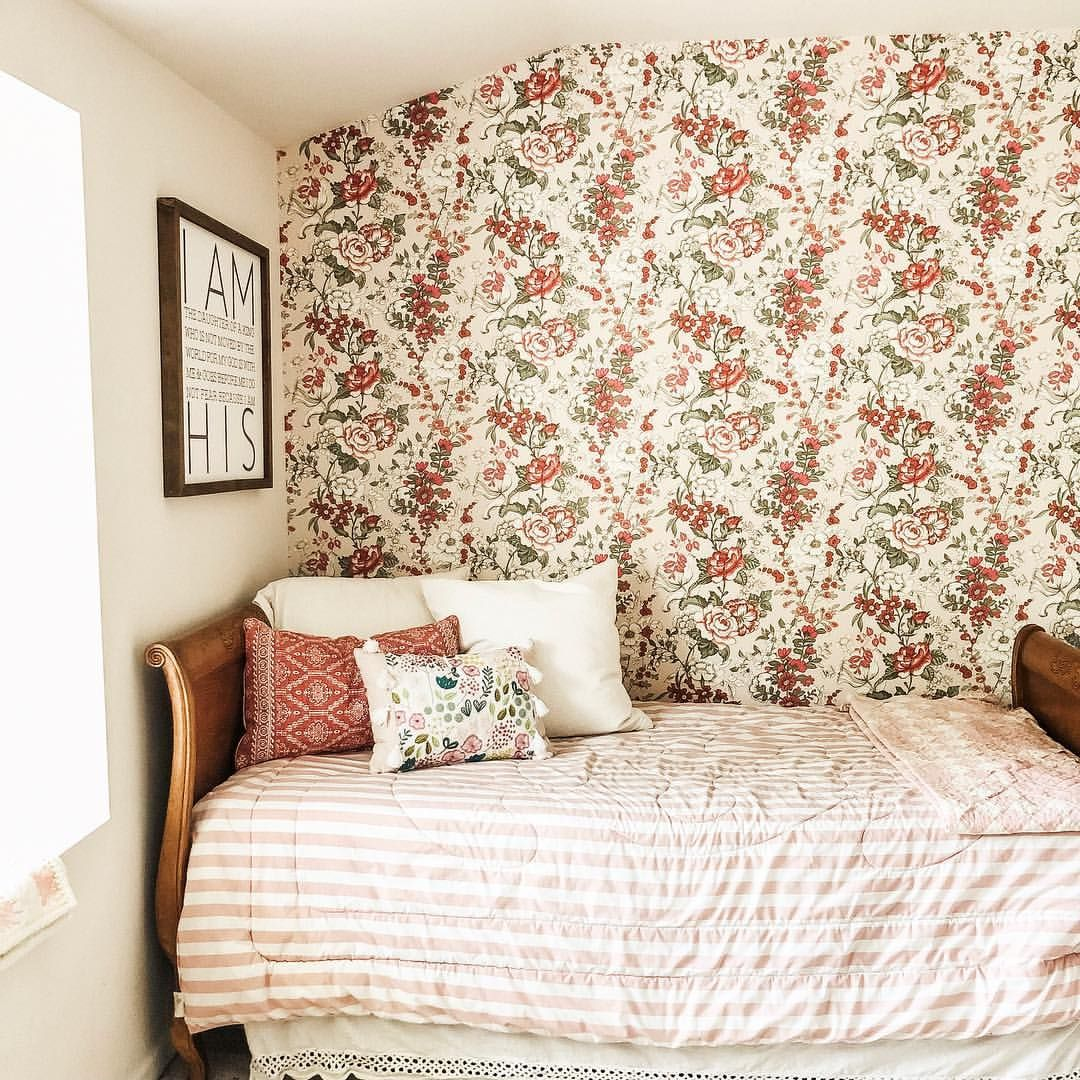 adorable little girls bedroom with pink floral wallpaper