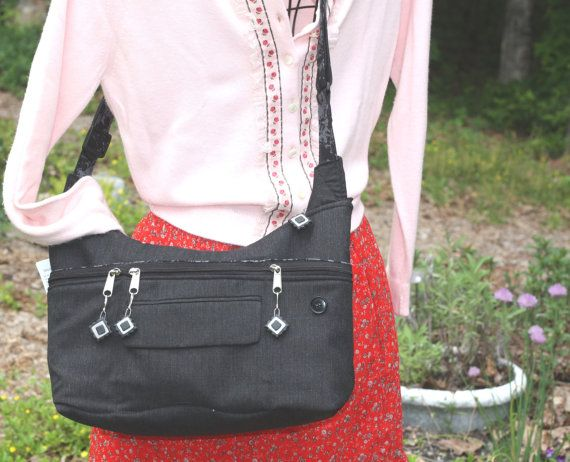 Pocketed Purse made from a recycled suit coat. Fully lined with lots of exterior and interior pockets.